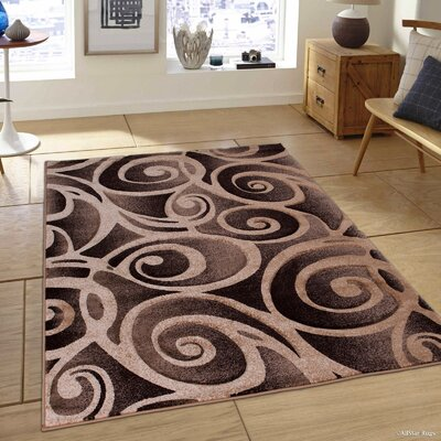 Evolution Swirl Champagne Area Rug Rug Size: 79 x 105