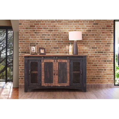 Pueblo TV Stand Color: Dark Brown, Width of TV Stand: 60
