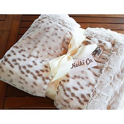 Armer Snow Leopard Couture Throw