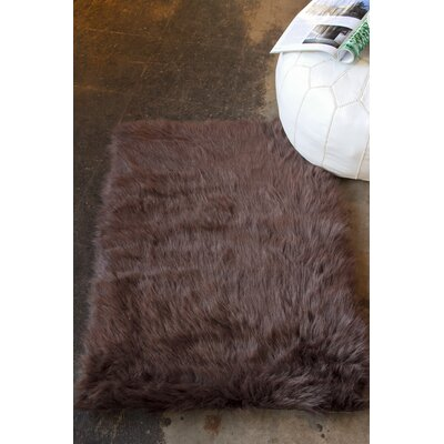 Shawnta Faux Sheepskin Chocolate Area Rug Rug Size: 2 x 3