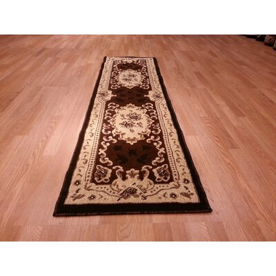 Hand-Carved Brown/Beige Area Rug Rug Size: Runner 27 x 146