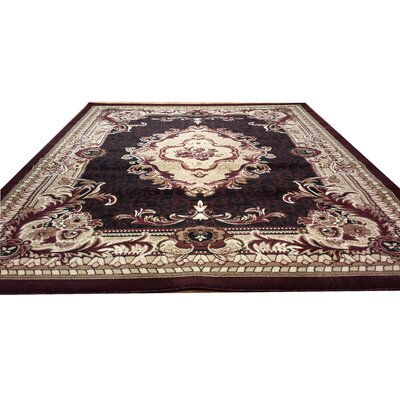Hand-Carved Red Area Rug Rug Size: 4' x 6'