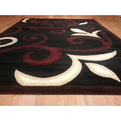 Hand-Carved Black/Red Area Rug Rug Size: 5'3
