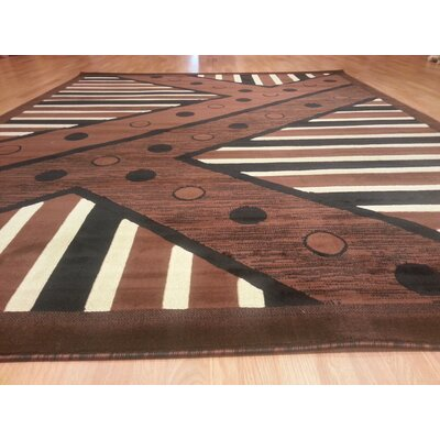 Hand-Carved Brown Area Rug Rug Size: 53 x 72