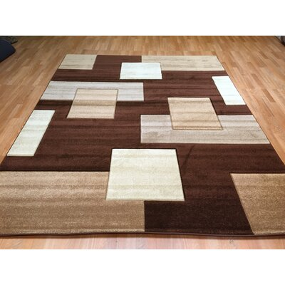 Hand-Carved Brown Area Rug Rug Size: 5'3