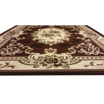 Hand-Carved Brown/Beige Area Rug Rug Size: Rectangle 53 x 72