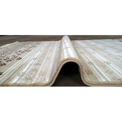 Cahlil Cream Area Rug Rug Size: 711 x 910