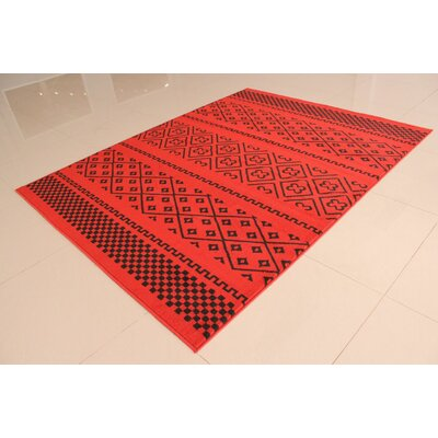 Ponton Black/Orange Area Rug Rug Size: 53 x 72