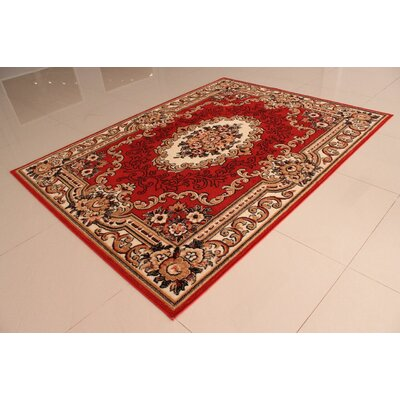 Nesbitt Orange Area Rug Rug Size: 53 x 72