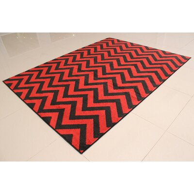 Riyan Black/Orange Area Rug Rug Size: 53 x 72
