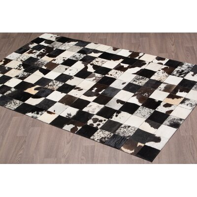 Touete Hand Woven Cowhide Black Area Rug
