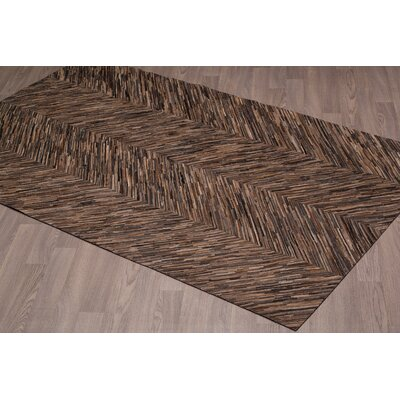 Charlaine Hand Woven Cowhide Chocolate Area Rug Rug Size: Rectangle 8 x 10