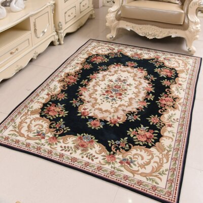 Classic Retro Black/Beige Area Rug Rug Size: Rectangle 46 x 66