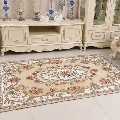 Classic Retro Beige Area Rug Rug Size: Rectangle 46 x 66
