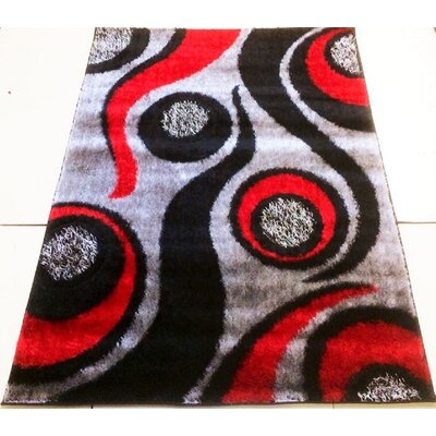 Gloria Gray/Black Area Rug Rug Size: 28 x 77