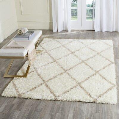 Macungie Beige Indoor Area Rug Rug Size: 10 x 14