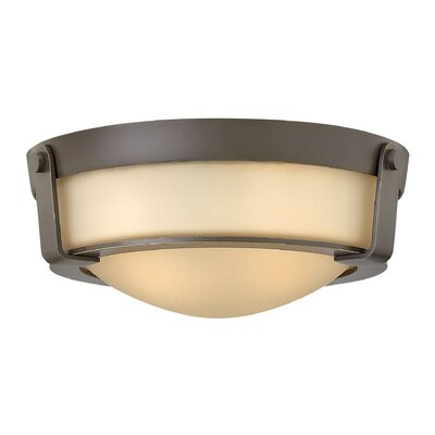 Raevon 2-Light Flush Mount Finish: Olde Bronze, Shade Color: Amber, Bulb Type: 13W GU24