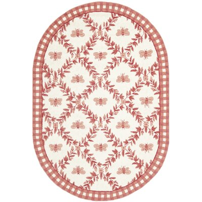 Kinchen Bumblebee Ivory & Rose Novelty Area Rug Rug Size: Oval 46 x 66