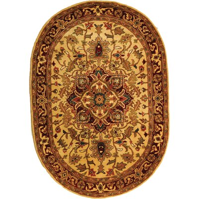 Classic Light Gold / Red Area Rug Rug Size: Oval 4'6