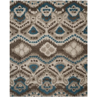 Tibetan Brown/Turquoise Ikat Rug Rug Size: Rectangle 8 x 10