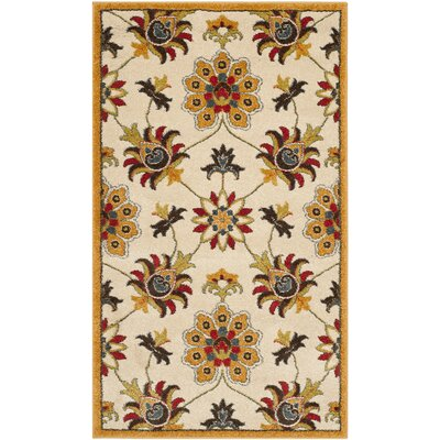 Hidden Creek Ivory/Gold Area Rug Rug Size: 51 x 76