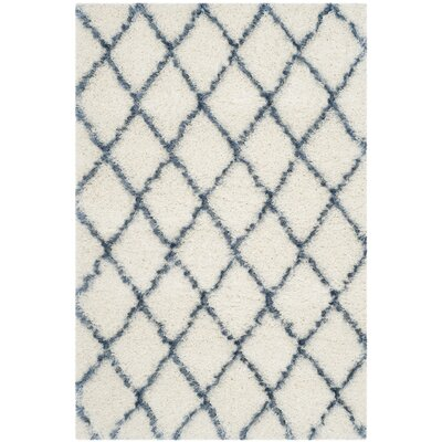 Armstead Ivory/Blue Area Rug Rug Size: Rectangle 86 x 12