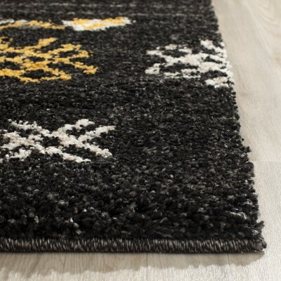 Tibetan Black/Gold Rug Rug Size: Rectangle 51 x 76