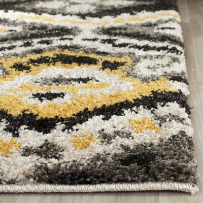 Tibetan Black/Gold Ikat Rug Rug Size: Rectangle 51 x 76
