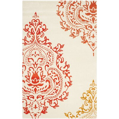 Isaac Mizrahi Beige/Orange Area Rug