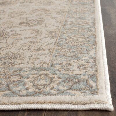 Vintage Ivory/Light Blue Area Rug Rug Size: Rectangle 51 x 77