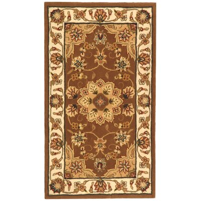 Traditions Tan/Ivory Area Rug Rug Size: 26 x 46