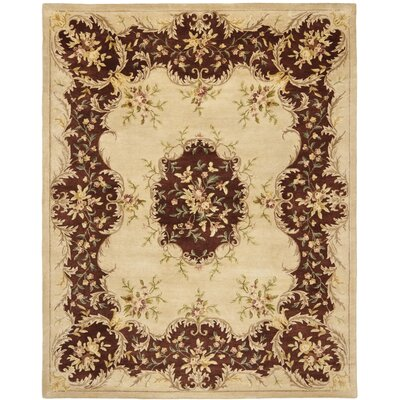 Bergama Ivory/Rust Area Rug Rug Size: Rectangle 5 x 8