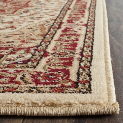 Theresa Ivory/Red Area Rug Rug Size: Rectangle 79 x 109