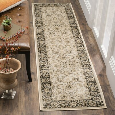 Mainville Ivory/Black Area Rug Rug Size: Rectangle 4 x 57