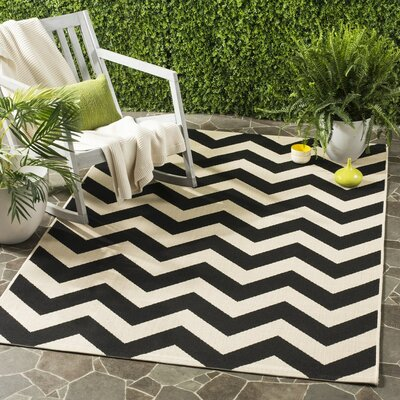 Jefferson Place Black & Beige Outdoor/Indoor Area Rug Rug Size: 5'3