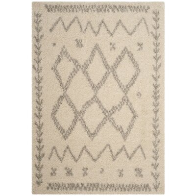 Amicus Beige/Gray Area Rug Rug Size: 67 x 92