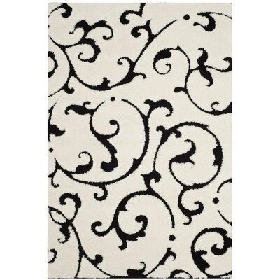 Tess Ivory/Black Area Rug Rug Size: Rectangle 86 x 12