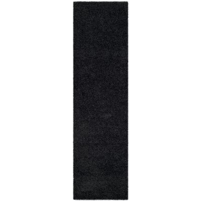 Wickline Black Area Rug