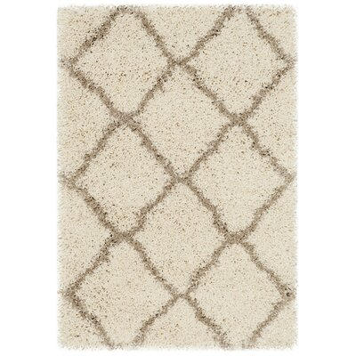 Buford Ivory/Beige Area Rug Rug Size: Rectangle 2 x 3