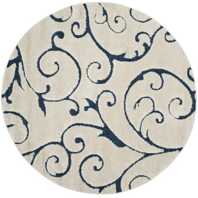 Alison Cream/Navy Blue Area Rug Rug Size: Round 67