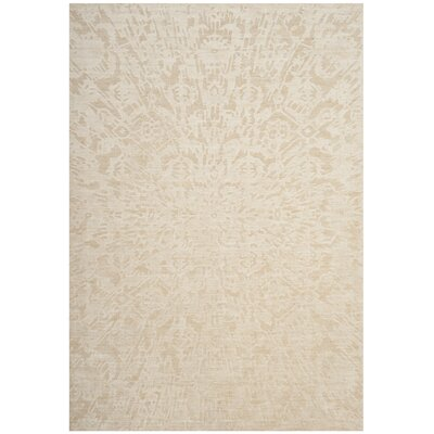 Juhi Hand Tufted Beige Area Rug Rug Size: Rectangle 6 x 9