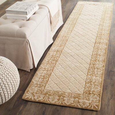 Caine Hand Tufted Ivory Area Rug Rug Size: Runner 23 x 9