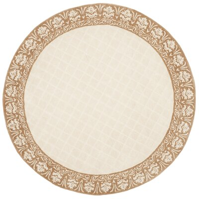 Caine Hand Tufted Ivory Area Rug Rug Size: Round 6