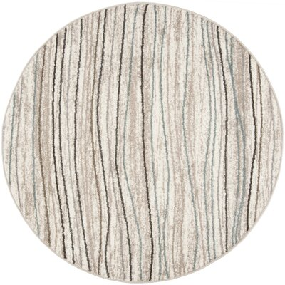 Quiros Cream/Beige Area Rug Rug Size: Rectangle 9 x 12