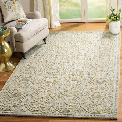 Charlenne Hand-Tufted Blue/Gold Area Rug Rug Size: Rectangle 5 x 8