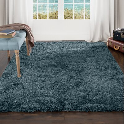Sculptured Blue Area Rug Rug Size: 5 x 77