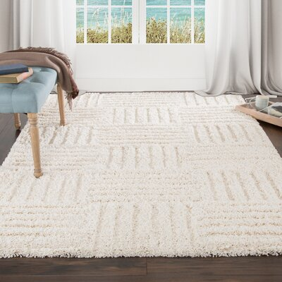 Sculptured Beige Area Rug Rug Size: 5 x 77