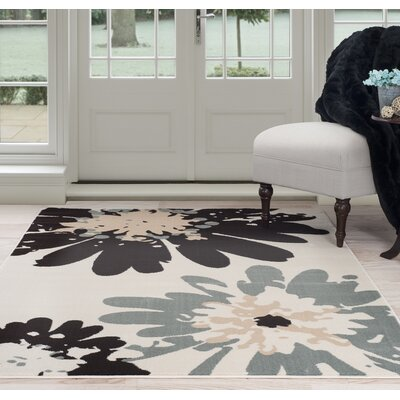 Flower Beige/Black Area Rug Rug Size: 5 x 77
