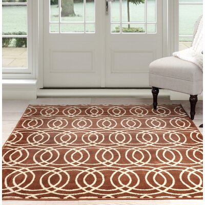 Geometric Orange/Beige Area Rug Rug Size: 5 x 77