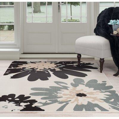 Flower Beige/Black Area Rug Rug Size: 33 x 5